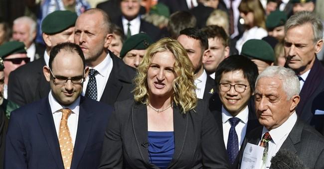 Court cuts sentence of UK marine who killed injured militant