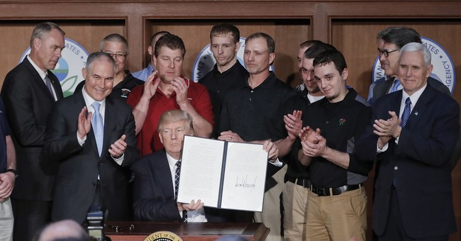 Trump, in break from other world leaders, digs in on coal