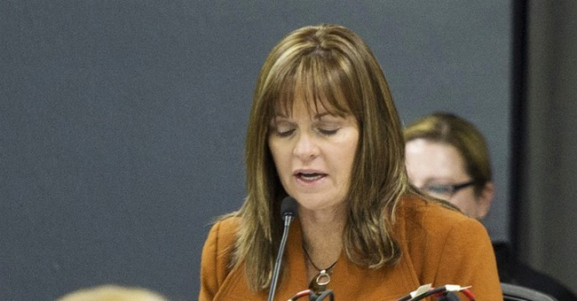 AP Exclusive: Iowa regulator keeps busy private law practice
