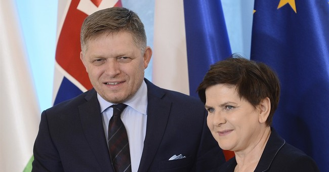 Central Europe's leaders reject EU's relocation of refugees
