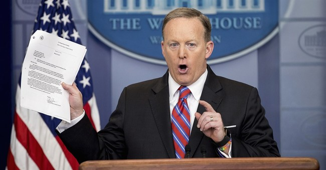 AP FACT CHECK: Spicer says case closed on Russia. It's not