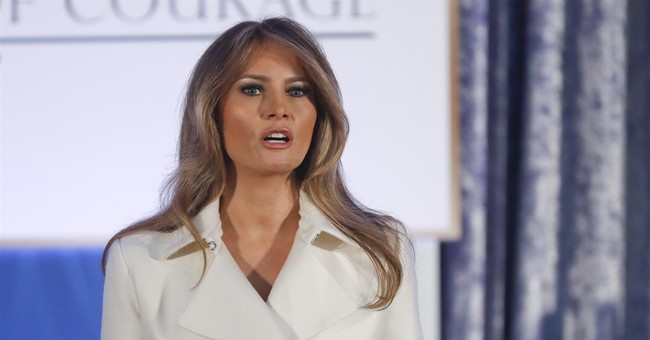 First lady helps present courage awards to 13 women