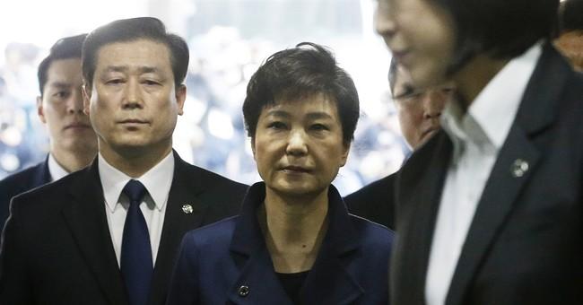 The Latest: SKorean president hopeful praises Park's arrest