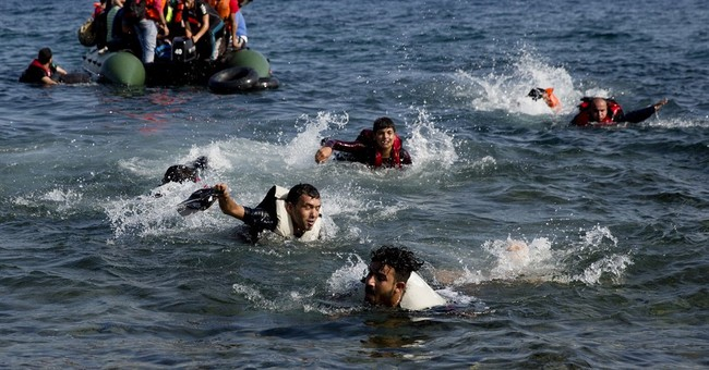 The Latest: Syrian refugee sets self on fire at Greek camp