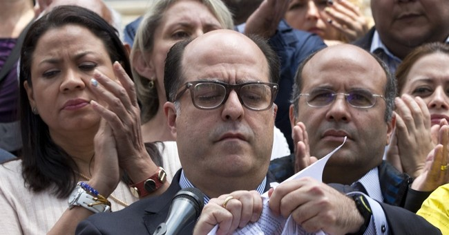 Denounced as a dictatorship, Venezuela backs down, reverses court ruling