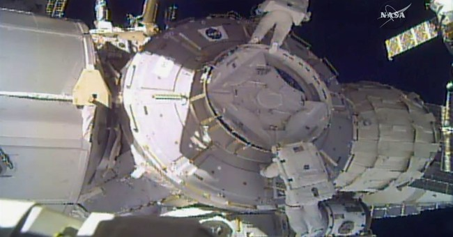 Spacewalkers lose piece of shielding, use patch instead