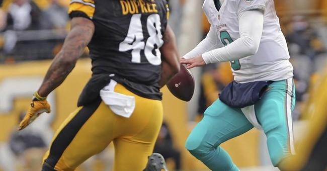 NFL, union begin review of concussion protocol on Miami QB