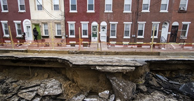 Philly sinkhole swallows car, interrupts utility services