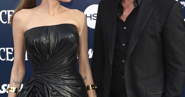 APNewsBreak: Jolie Pitt and Brad Pitt reach divorce pact