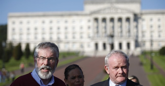 Belfast power-sharing shaken as top Sinn Fein figure resigns