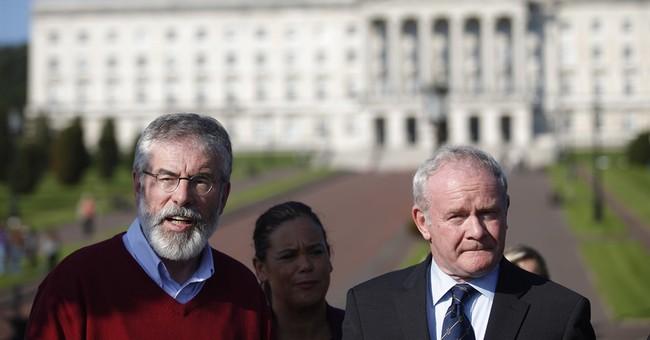 Belfast power-sharing shaken as top Sinn Fein figure resigns