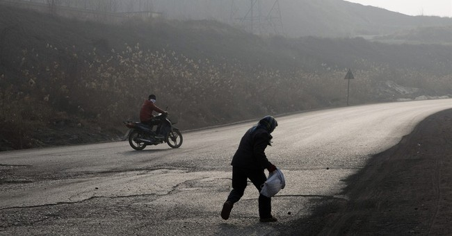 China's poorest, trying to stay warm, add greatly to smog