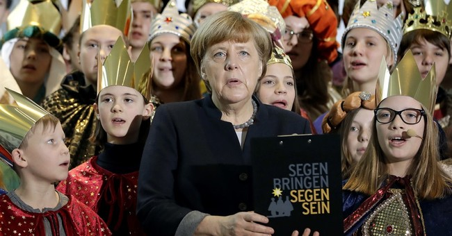 Merkel pledges quick security action after Berlin attack