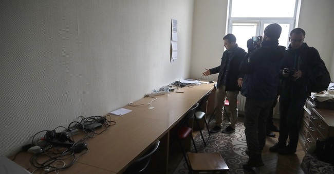Belarus police raid offices of Polish-funded TV