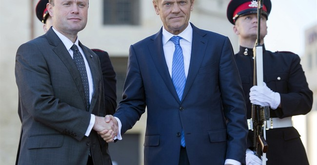 The Latest: EU foreign chief: defense OK despite Brexit