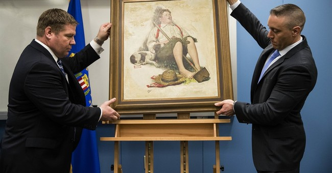 Family recognized stolen Rockwell painting by pool-cue hole