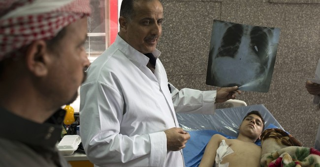 Hospital struggles with Mosul's injured _ and its dead