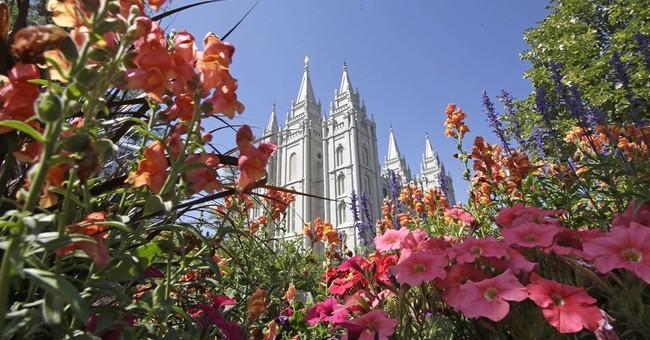 The Latest: Mormons leader preaches inclusivity