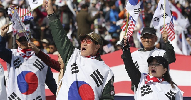SKorean supporters of arrested ex-president protest in Seoul
