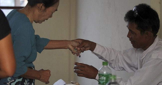 Myanmar by-elections take pulse of Suu Kyi's popularity