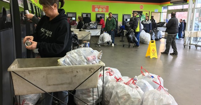 The Latest: Oregonians cash in on increased bottle refunds