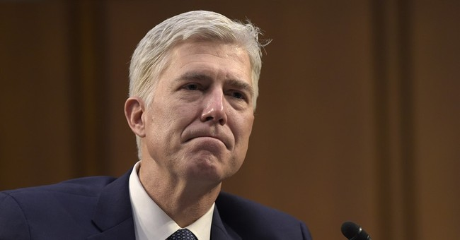 The Latest: Tester says he won't support Gorsuch nomination