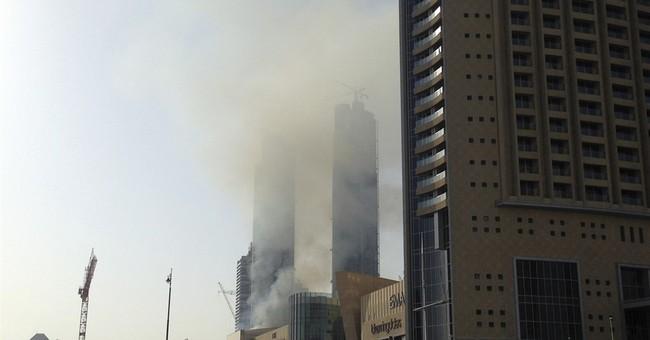 Fire hits Dubai high-rise complex near world's tallest tower