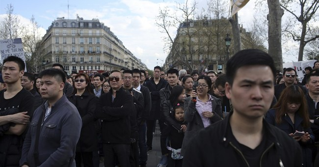 Thousands gather in Paris over police killing of Chinese man