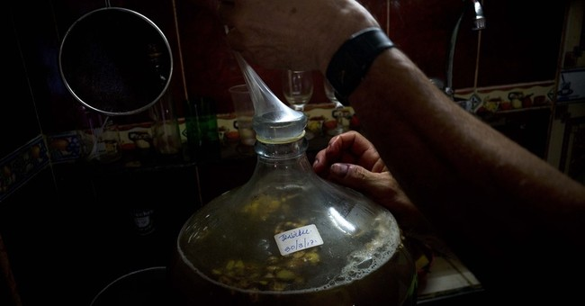 Cuban uses condoms, tropical fruit to make own brand of wine