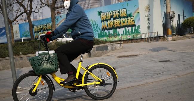 AP PHOTOS: Bike-sharing rivalry crowds Beijing's sidewalks