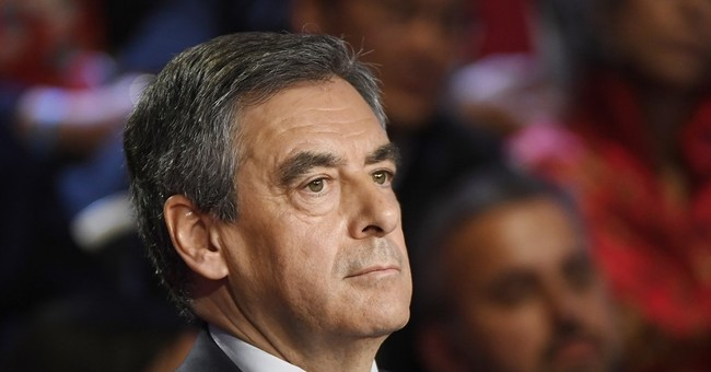 The Latest: French candidate Fillon is doused with flour