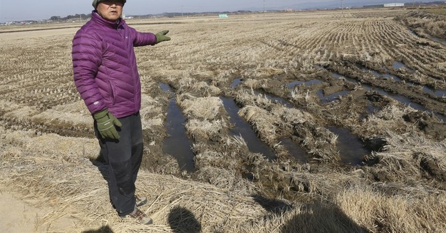 In S. Korea, ex-vagrants want land promised for forced labor