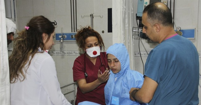 Analysis: Toxic attack could wreck Assad's political gains