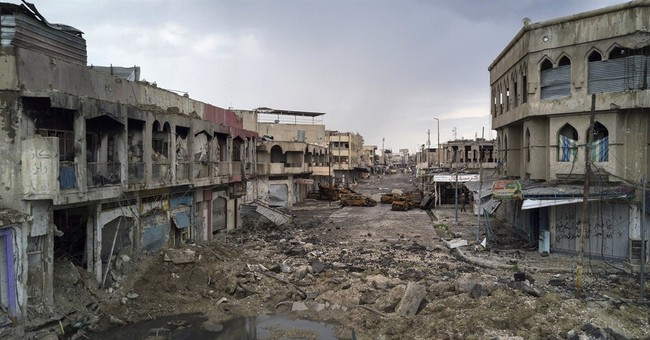 Iraq suicide bombings in Tikrit, north of Baghdad, kill 22
