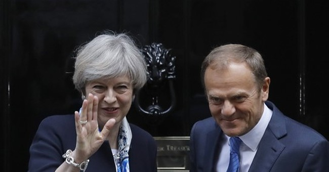 EU's Tusk, Britain's May seek smooth start to Brexit talks