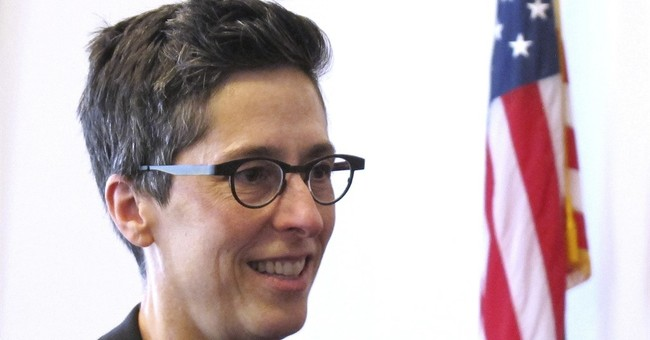 Cartoonist laureate says world has changed, accepts gay work