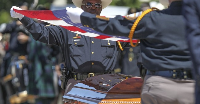 Slain Texas lawman remembered as 'smartest guy in the room'