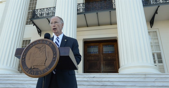 Alabama governor defiant as sex scandal trouble mounts