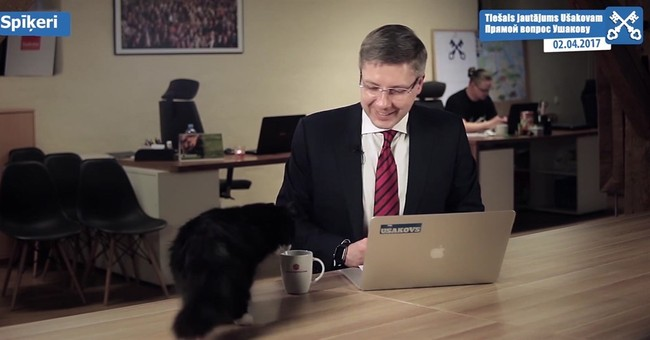 Riga mayor talks about potholes, interrupted by cat