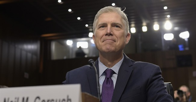The Latest: With Gorsuch, high court takes conservative tilt