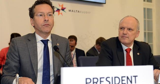 Eurozone head defends himself over 'liquor and women' remark
