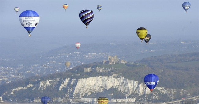 Hot-air balloons cross Channel in colorful record attempt