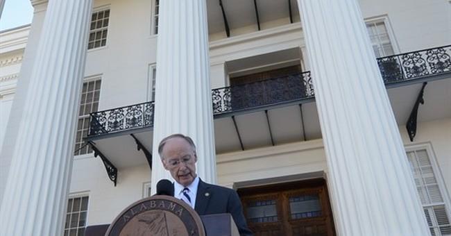 Alabama governor halts impeachment, not disparaging report