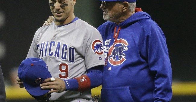 Wild pitch gets Brewers get 2-1 win in 11th, Cubs' Baez hurt