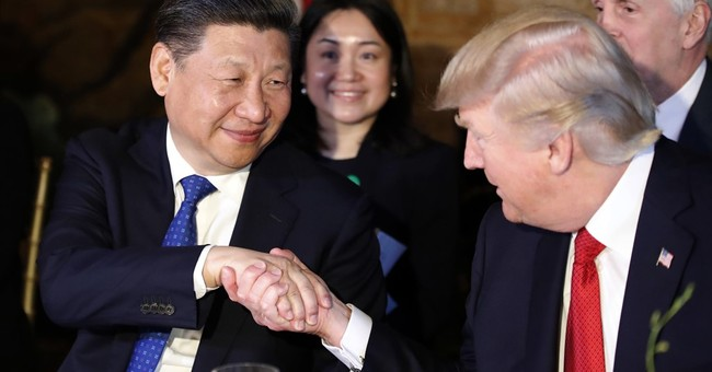 Chinese state media say Trump to visit China in 2017