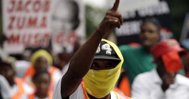 South Africans protest Zuma as country downgraded to junk