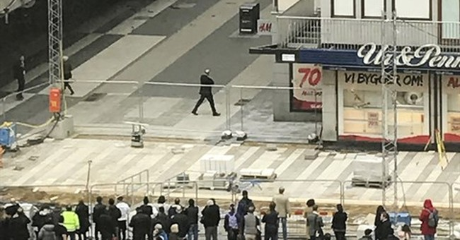 The Latest: Swedish police haul away truck used in attack