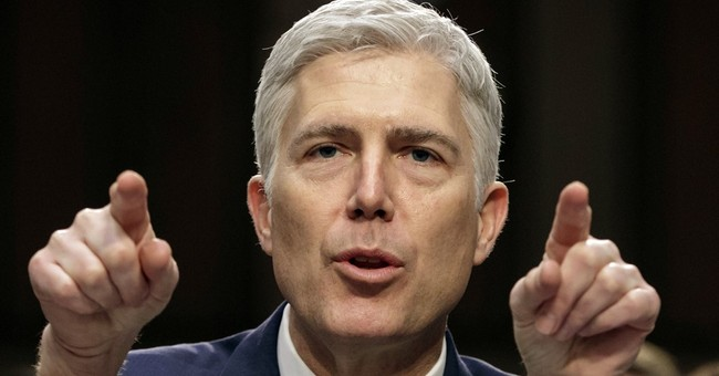 The Latest: Trump praises Gorsuch after confirmation