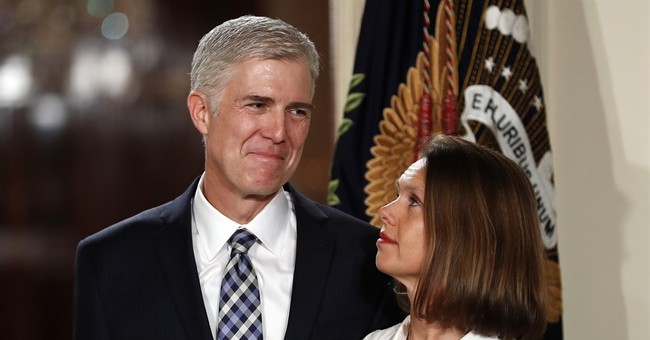 Joining high court, the real Neil Gorsuch set to stand up