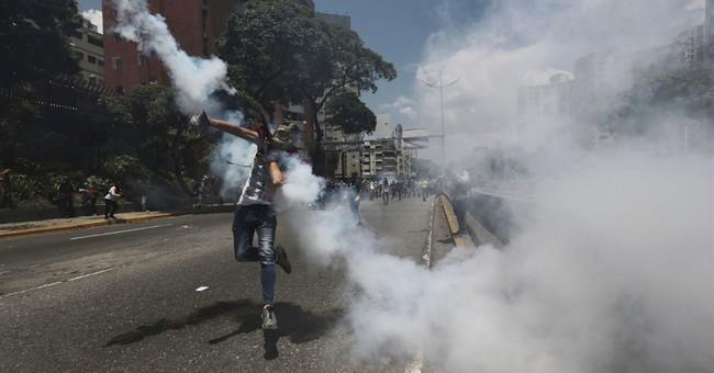 Venezuelans pour into Caracas streets in anti-Maduro protest